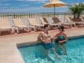Couple enjoying beachfront pool in Wildwood