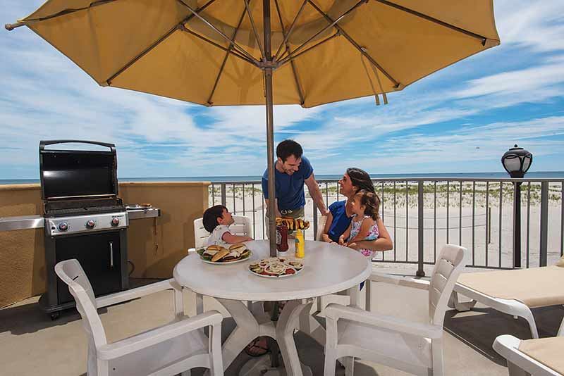 Wildwood Crest Hotel with BBQ Grille for guests on the deck